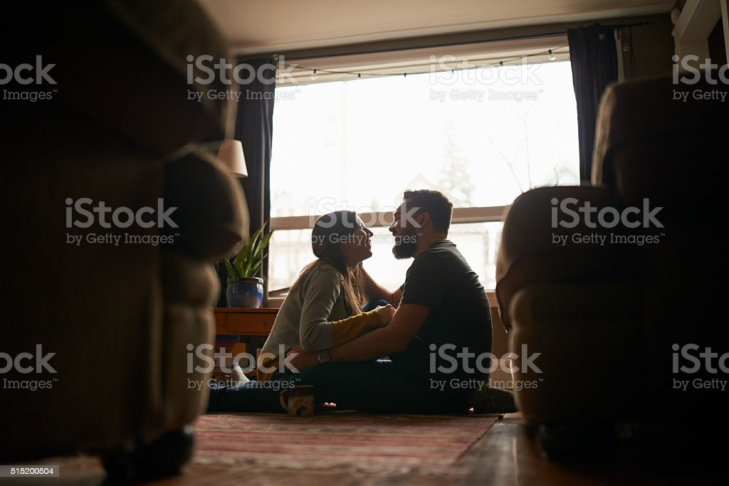 Looking lovingly into one another's eyes stock photo