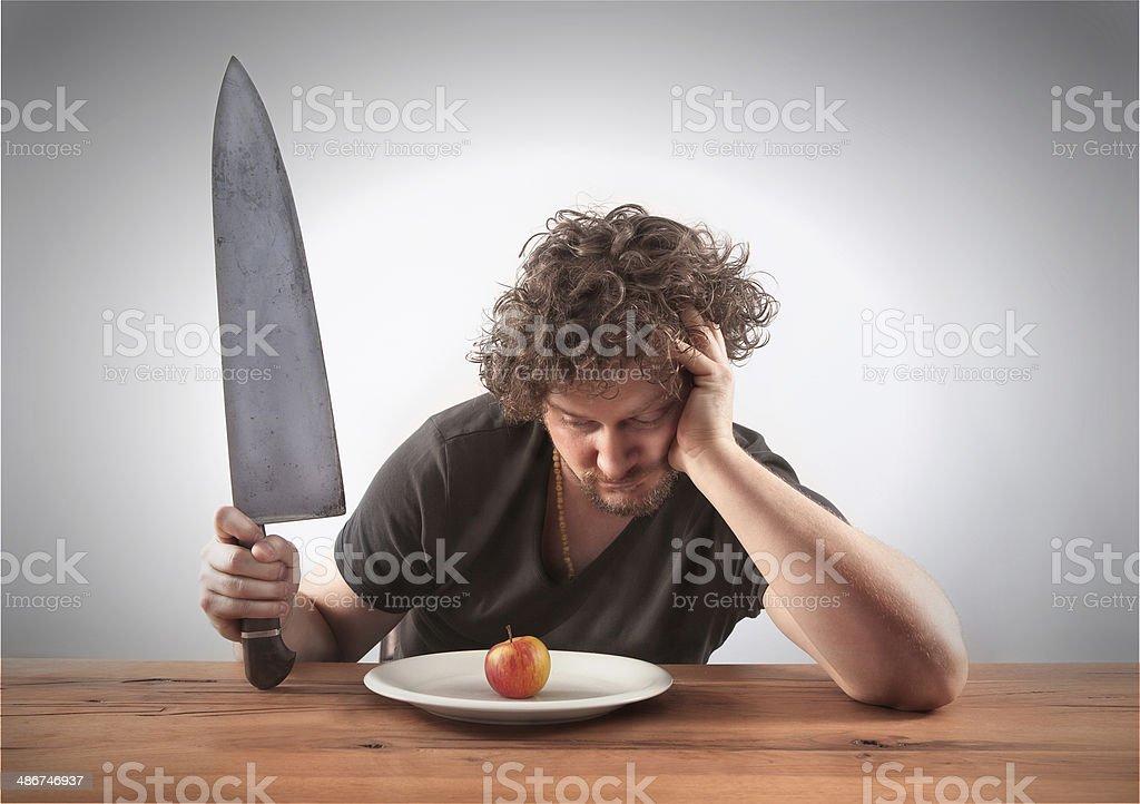 Looking on a little apple stock photo