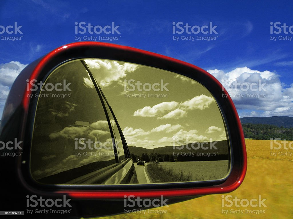 Looking Out Car Window with B&W Reflection in Side Mirror stock photo