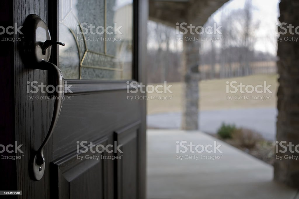 Looking out from inside home through open front door stock photo