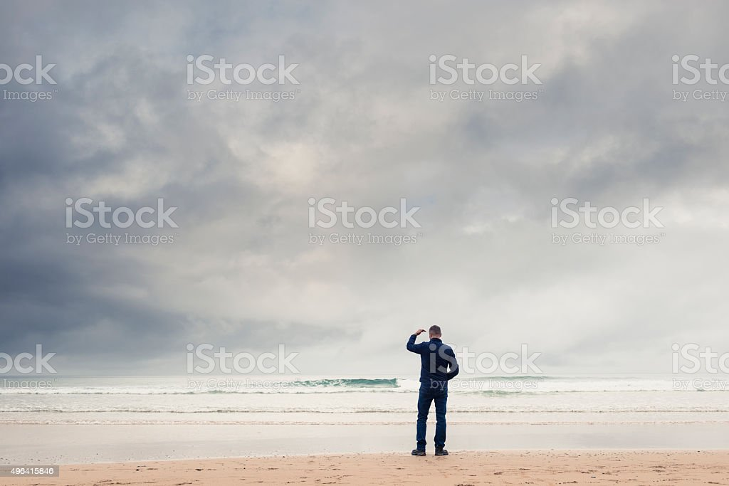 looking out over the coast in overcast conditions. stock photo