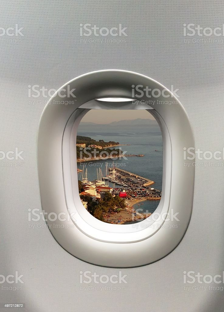 Looking out the window of a plane stock photo