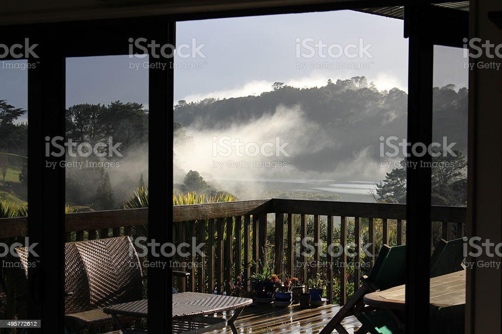 Looking out through the doors on a misty morning stock photo