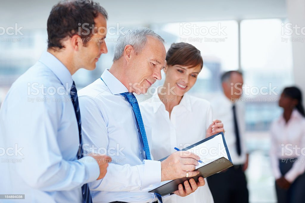 CEO looking over deal royalty-free stock photo