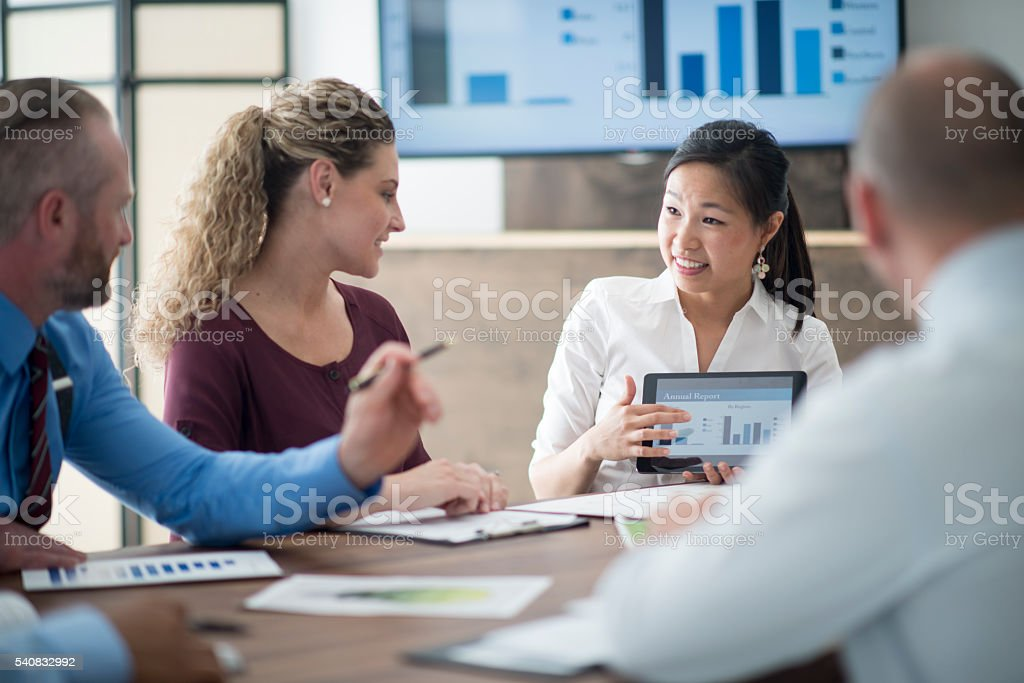 Looking Over Facts and Figures stock photo