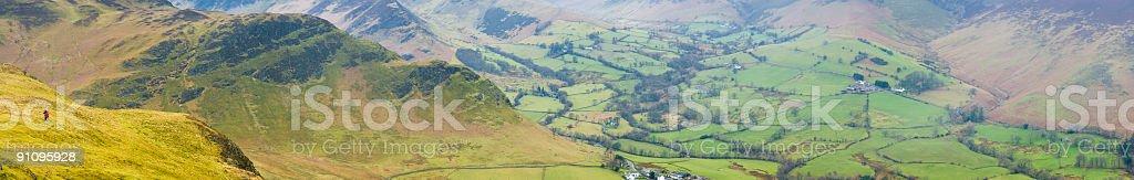 Looking over mountain farms stock photo
