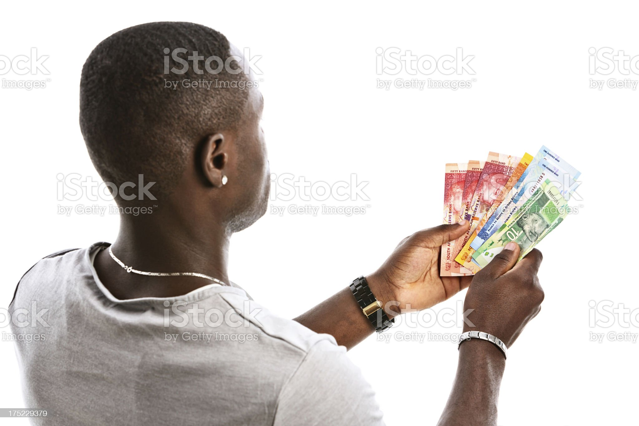 Looking over shoulder of man holding South African banknotes royalty-free stock photo