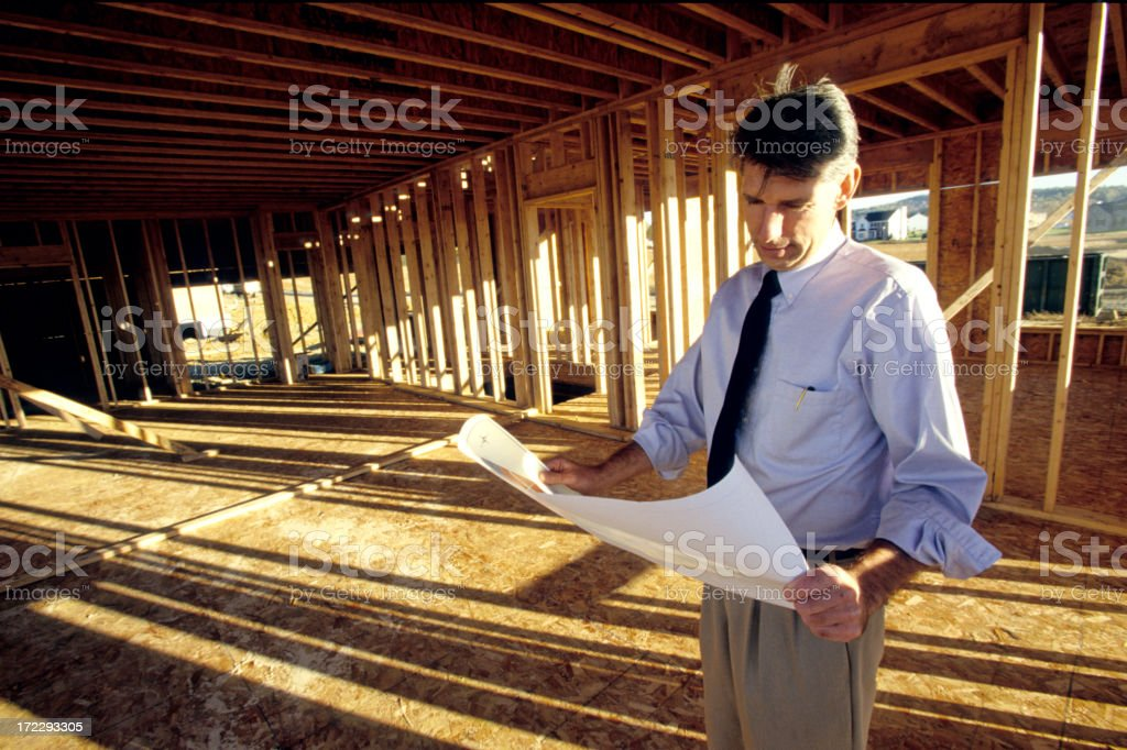 looking over site plans royalty-free stock photo