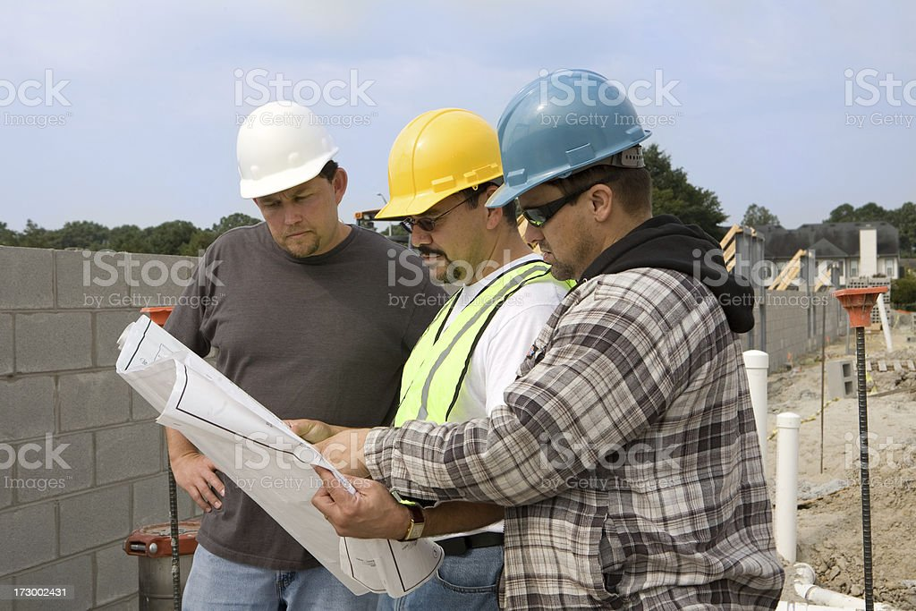 looking over the plans royalty-free stock photo