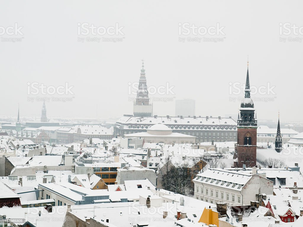 Looking over the snow covered roofs of Copenhagen stock photo