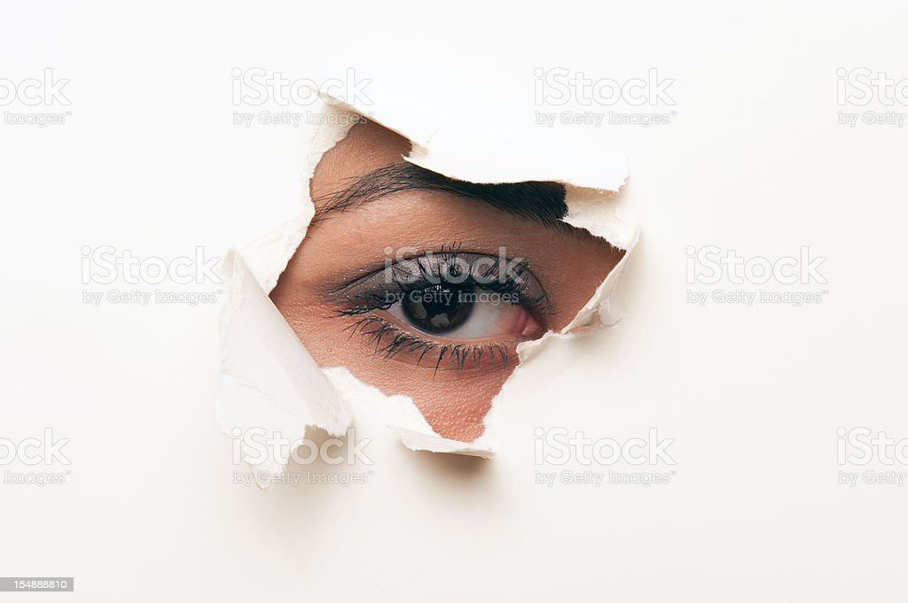 looking through a hole in the paper royalty-free stock photo