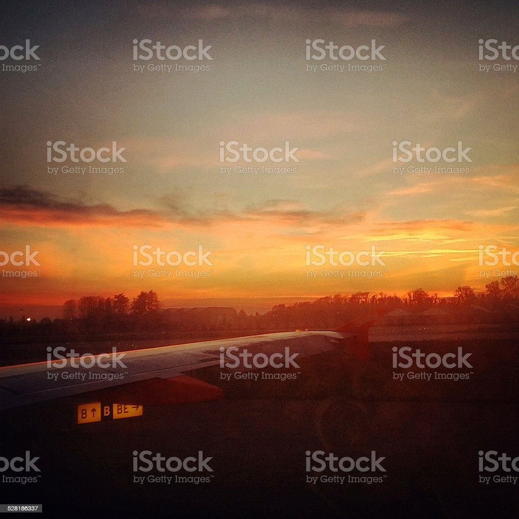 Looking through airplane window at sunset stock photo