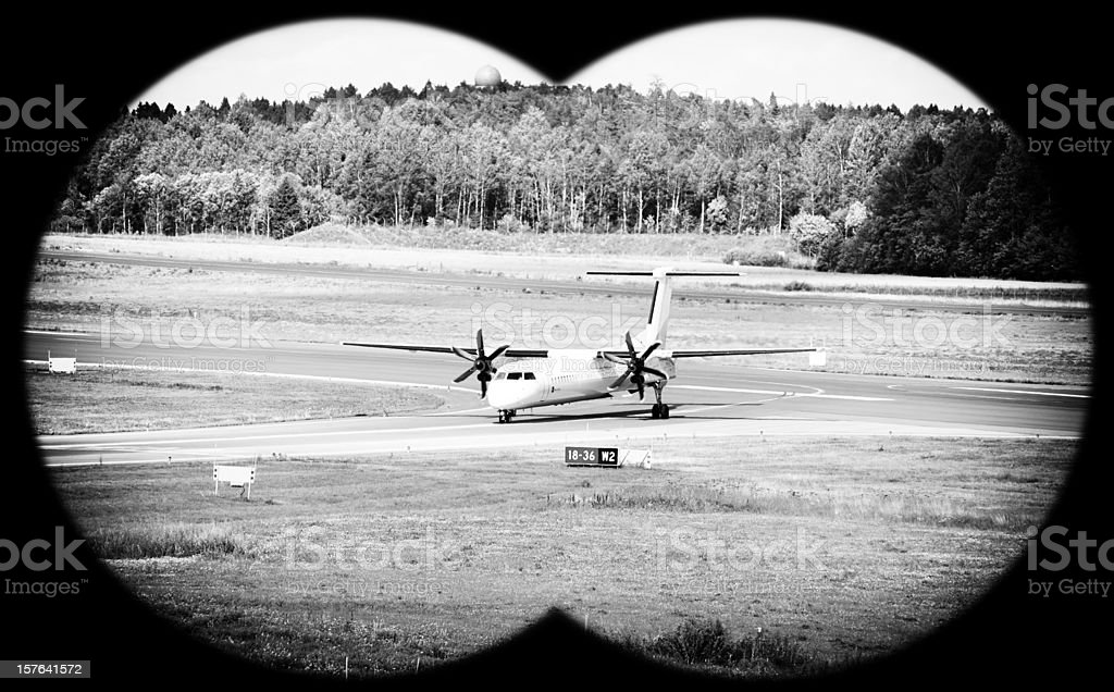 looking through binocular hole in the airport royalty-free stock photo