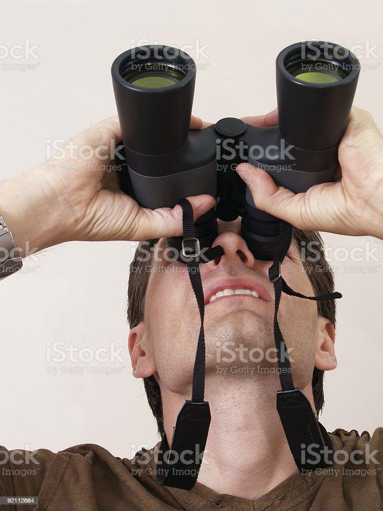 Looking Through Binoculars royalty-free stock photo