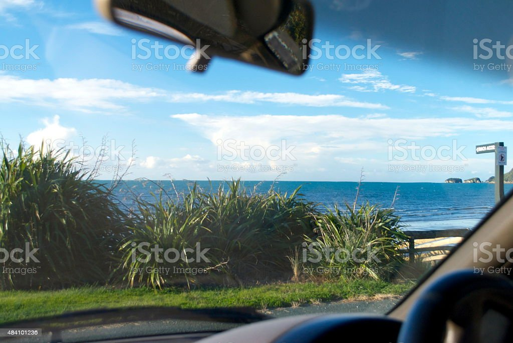 Looking through Car Windscreen to the Beach stock photo