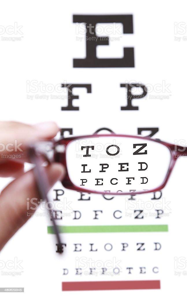 Looking through eyeglass stock photo