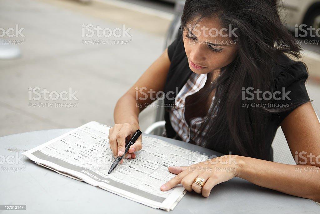 Looking Through Job Listings royalty-free stock photo