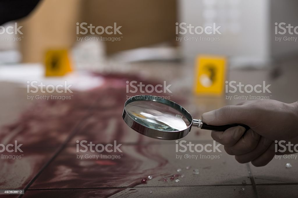 Looking through magnifying glass stock photo