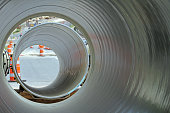 Looking Through Sections Of Large Diameter Water Pipe