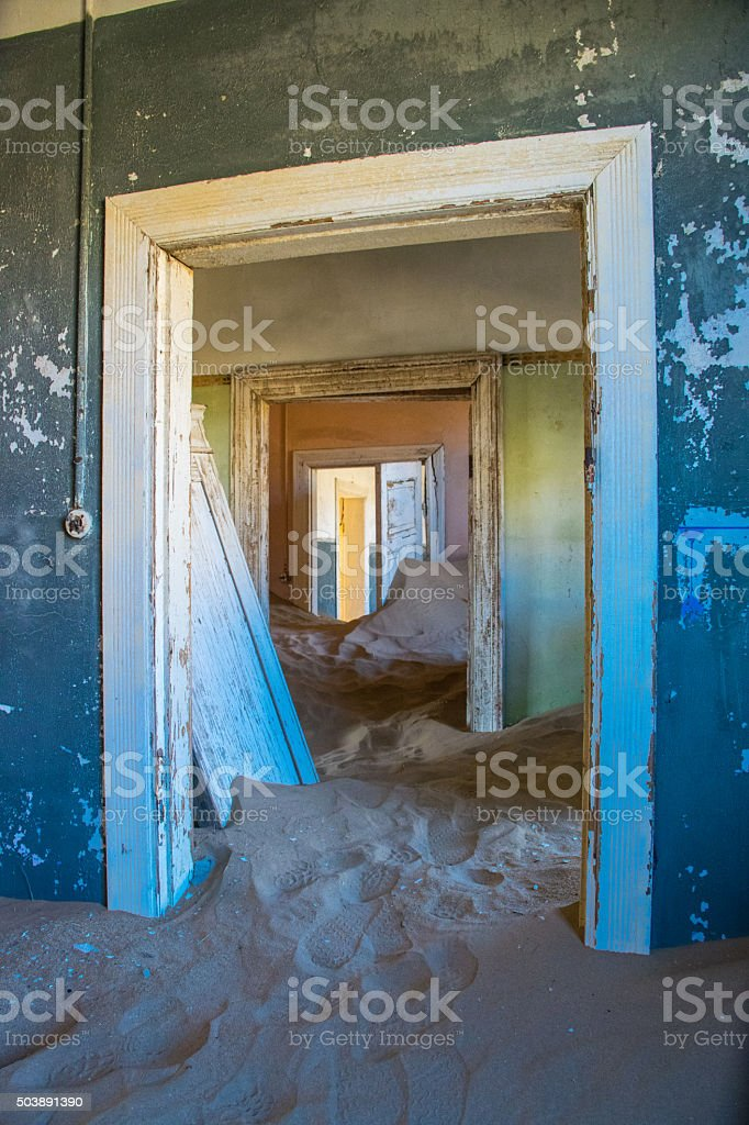 Looking through the door in Kolmanskop, Namibia stock photo
