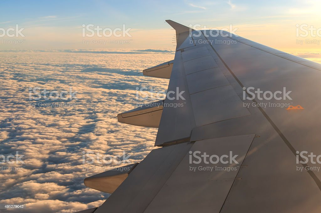 Looking through the window aircraft at sunset during the flight stock photo
