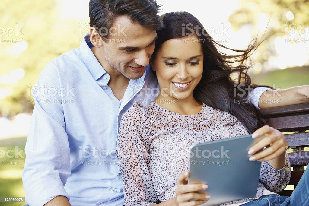 Looking through their digital photo album royalty-free stock photo