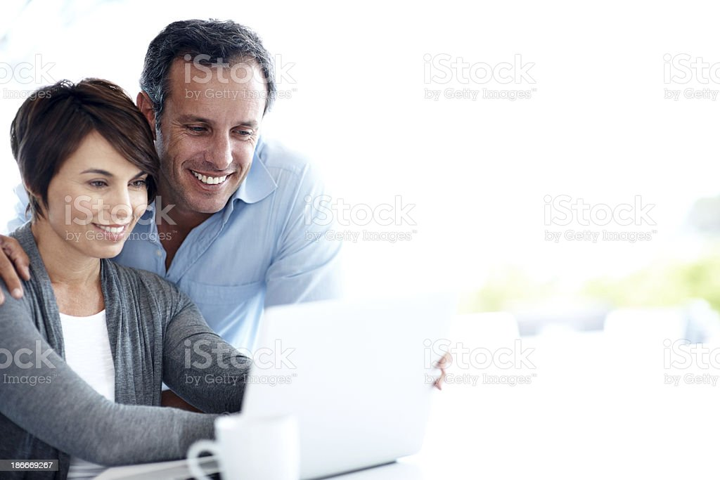 Looking through their vacation pictures royalty-free stock photo