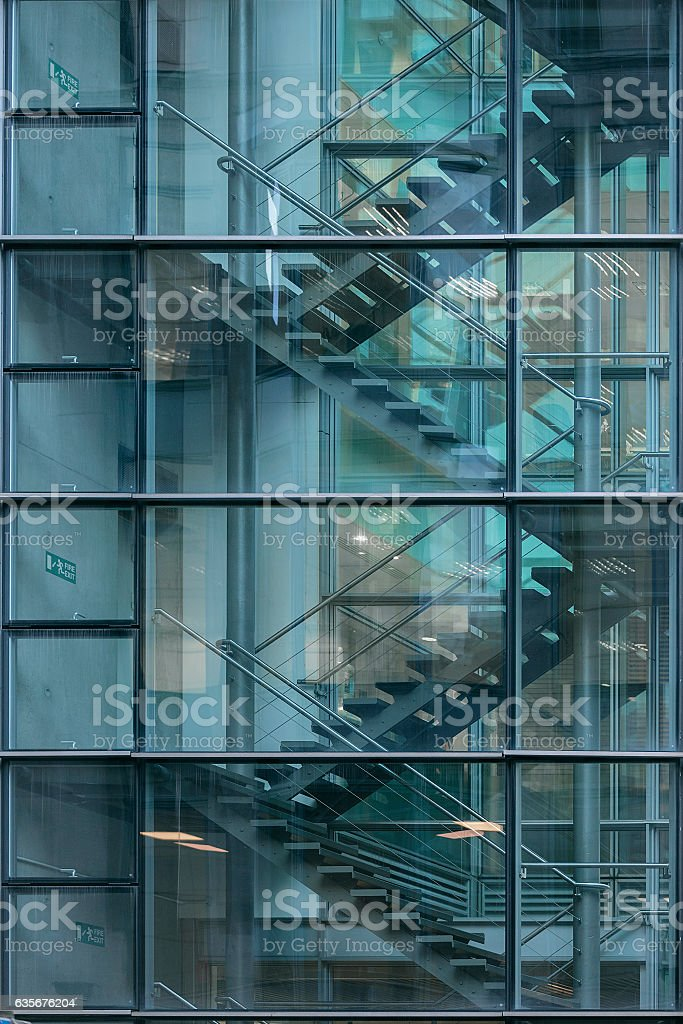 Looking through window at staircase in office building stock photo