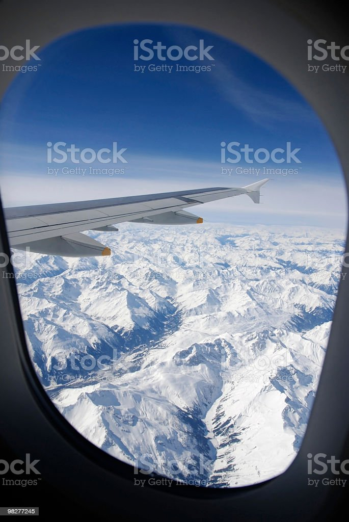 looking through window on flight over the snowcovered Apls royalty-free stock photo