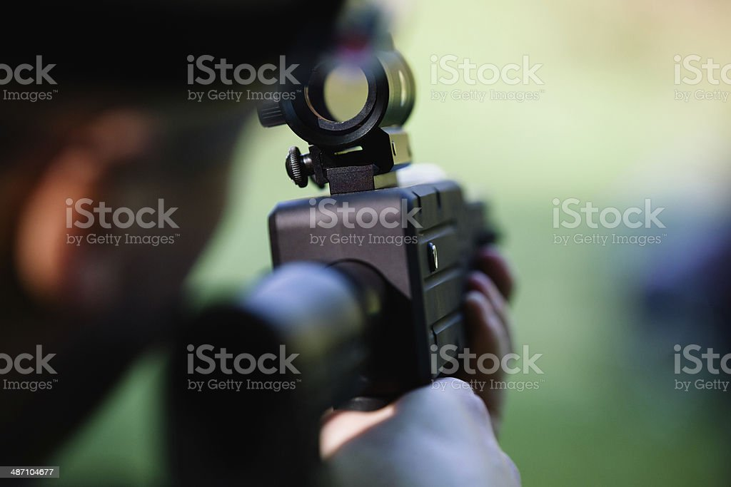 Looking throught the rifle scope stock photo