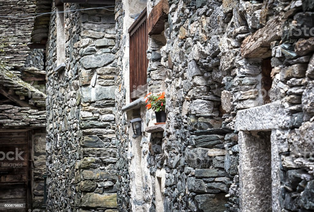 Looking to a small alley in the village Rovesca stock photo