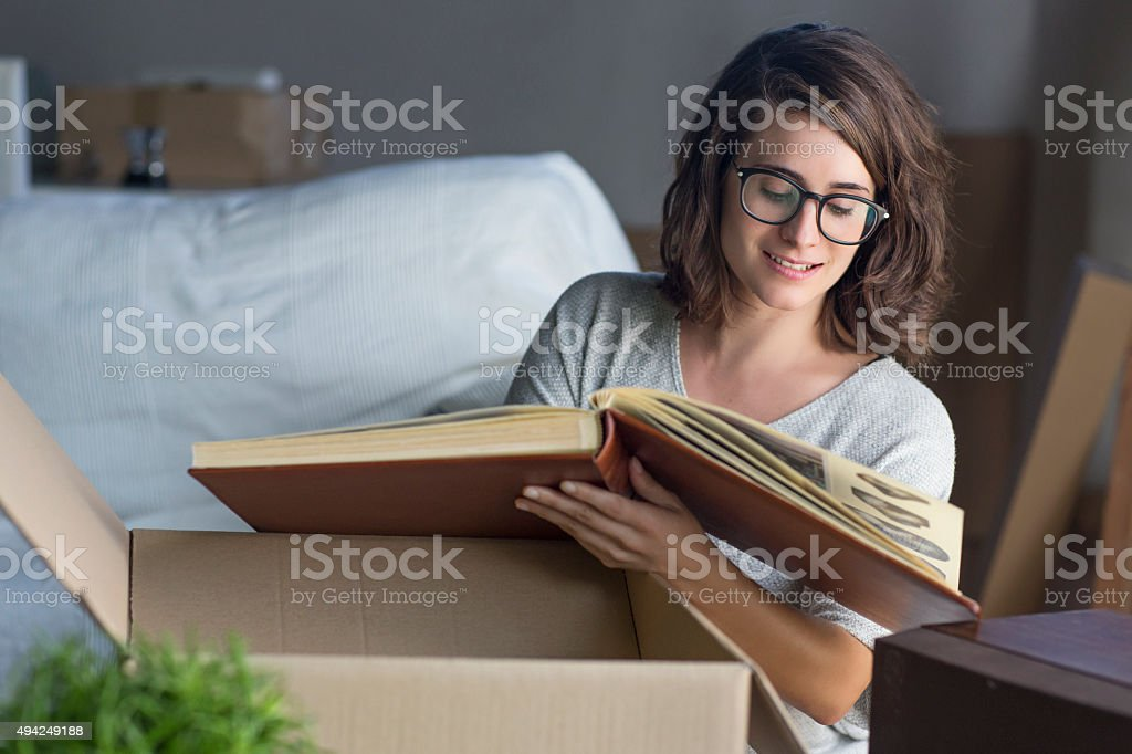 Looking to an old album stock photo