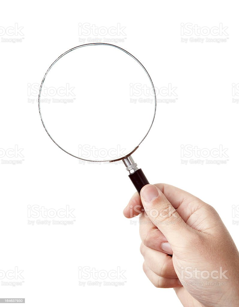 Looking trough magnifying glass in hand royalty-free stock photo