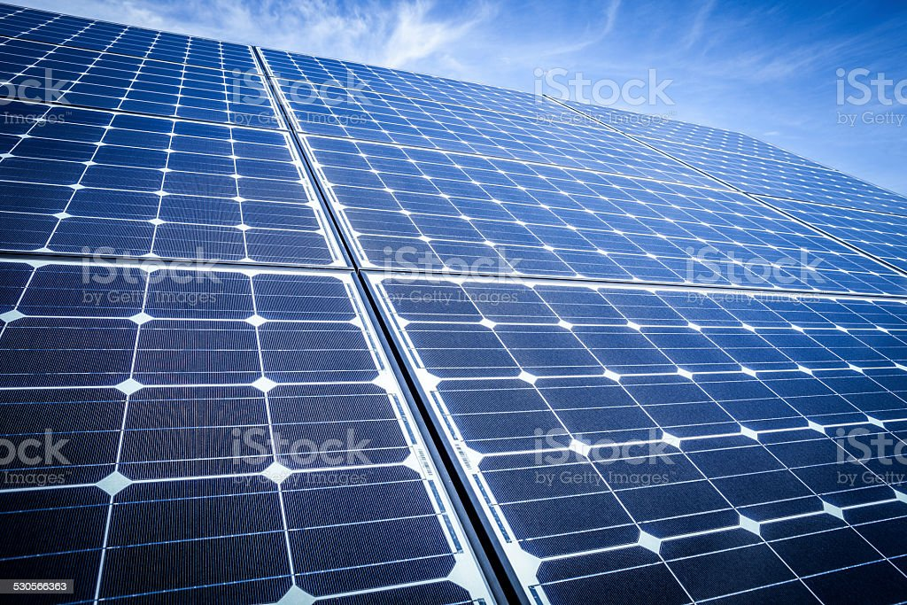 Looking Up Along Solar Panels In Extreme Perspective stock photo