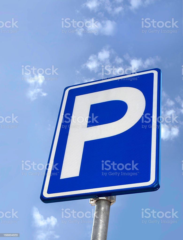 Looking up at a blue parking sign with white border royalty-free stock photo