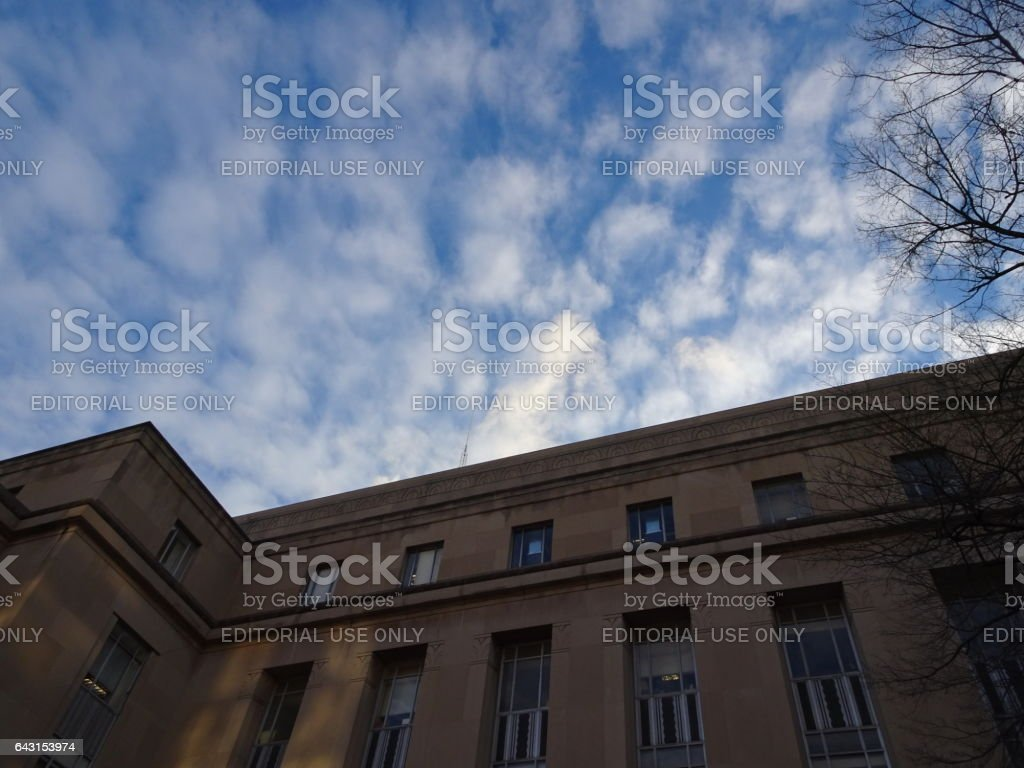 looking up at a courthouse and the sky stock photo