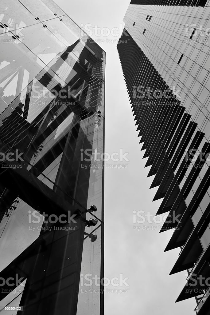 Looking up at a Glass Elevator and Skyscraper royalty-free stock photo