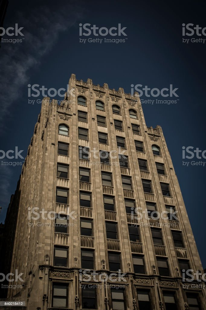 Looking up at a gothic style high rise stock photo