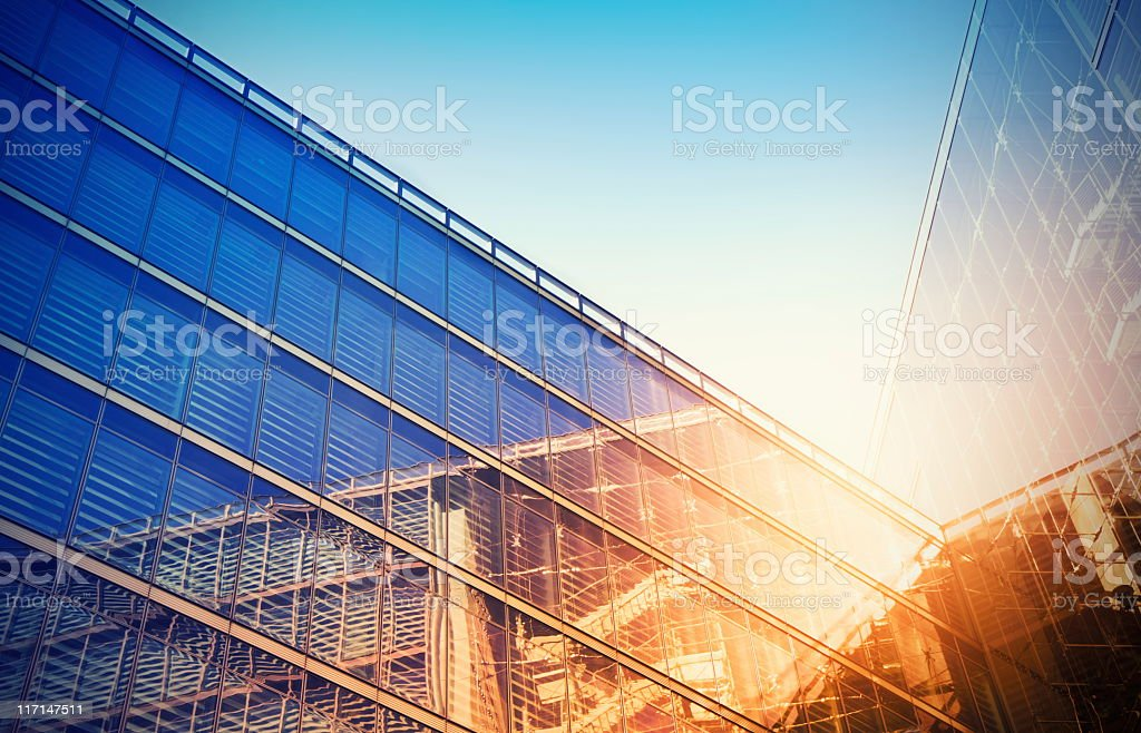Looking up at a modern glass building stock photo
