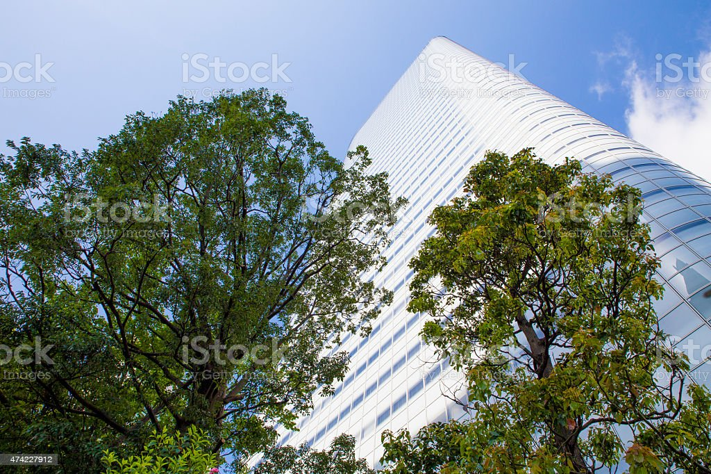 looking up at a skyscraper in Shiodome district, Tokyo, Japan stock photo
