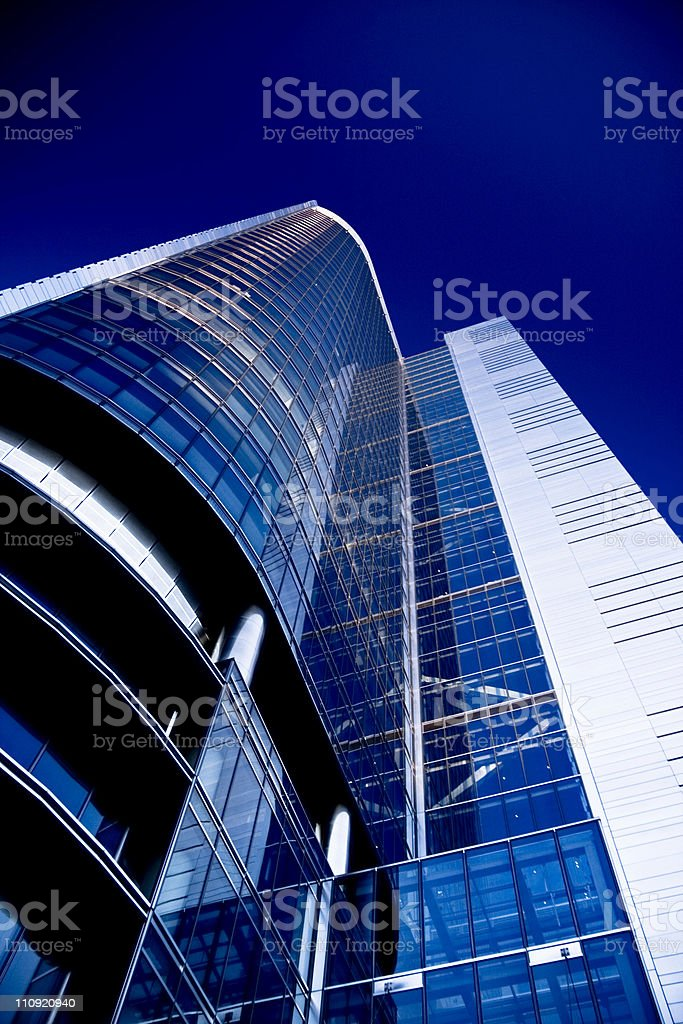 Looking up at blue glass modern apartment in Toronto stock photo