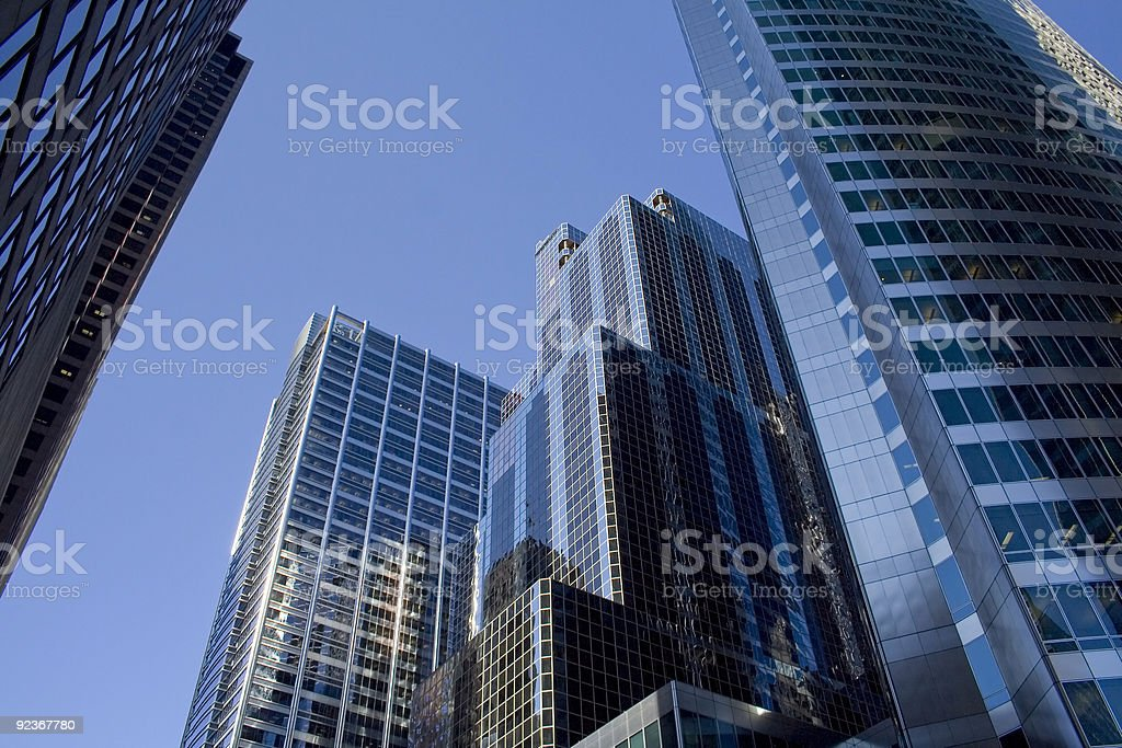 Looking up at blue glass modern office building in Chicago stock photo