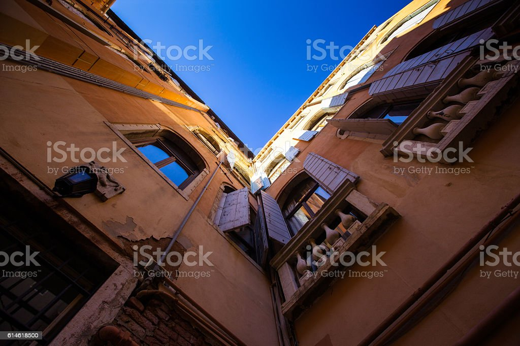 Looking Up at Building in Venice Courtyard stock photo