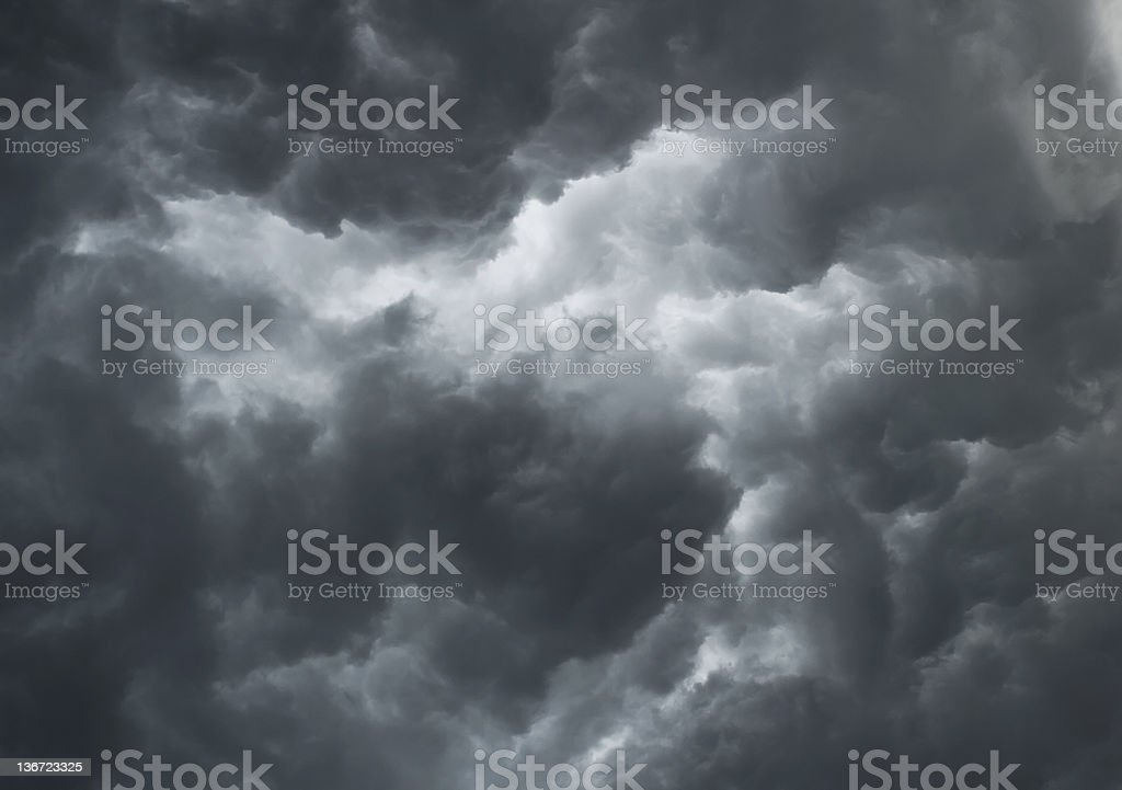 Looking up at dramatic stormy gray clouds royalty-free stock photo