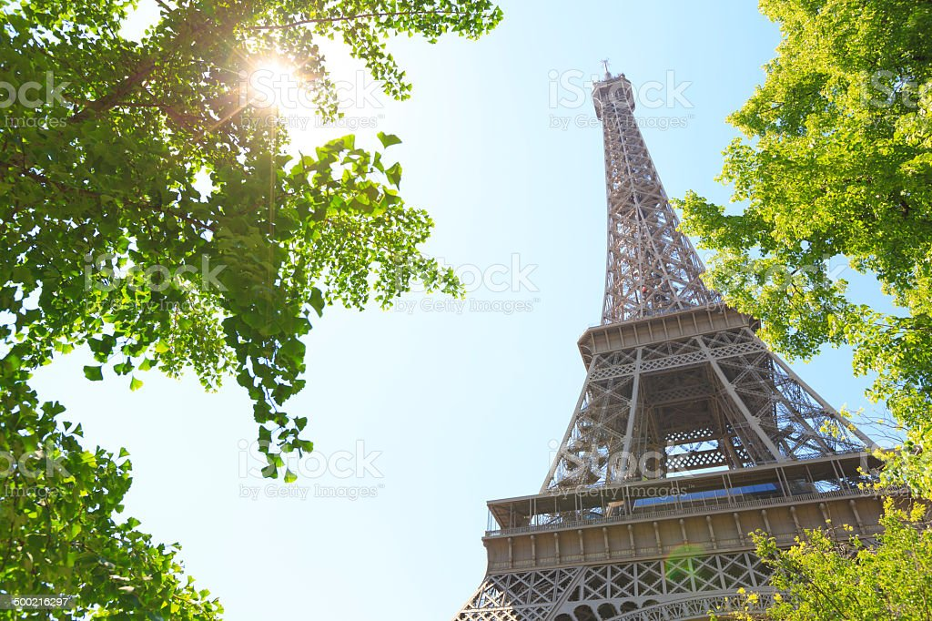 Looking up at Eiffel tower in Paris, France stock photo