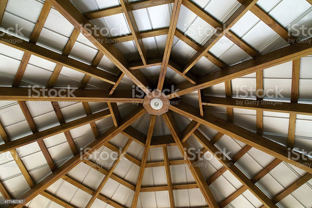 looking up at  eight sided exposed beam roof stock photo