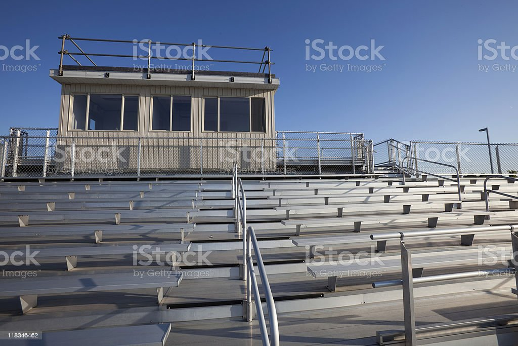 Looking Up At Empty Bleachers And Grandstand Against Clear Sky stock photo