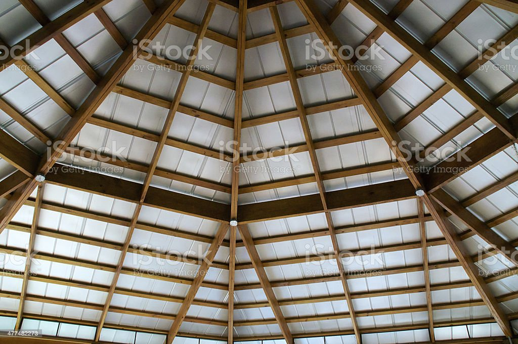 looking up at exposed beam roof stock photo
