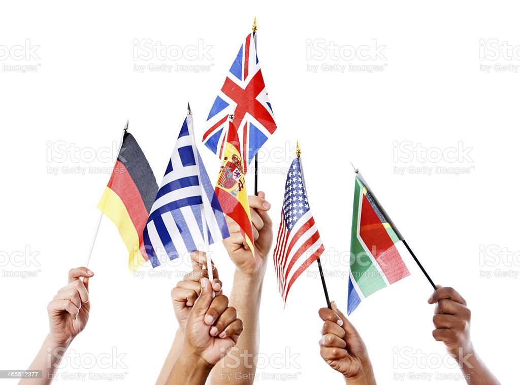 Looking up at hands holding multi-national flags. Isolated on white, stock photo