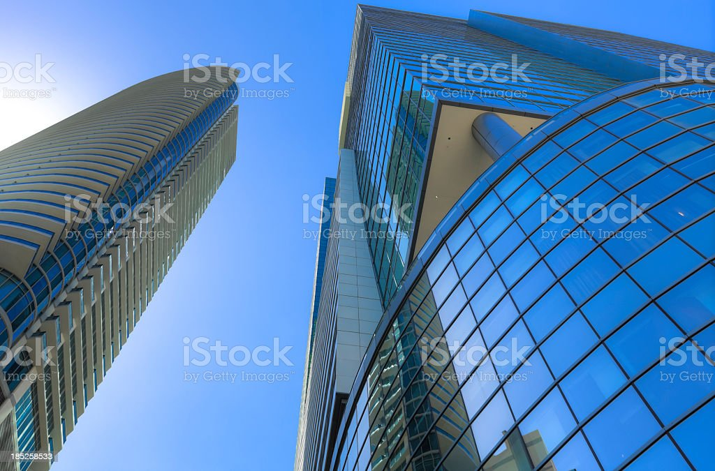 Looking up at modern buildings stock photo
